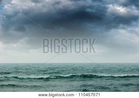 Stormy Intense Dark Clouds Over The Ocean