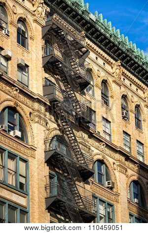 Soho Brick Building With Fire Escape, Ornate Cornice, New York