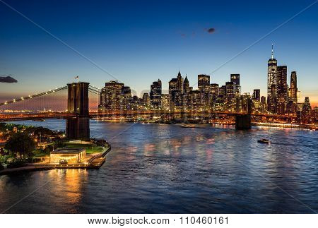 Brooklyn Bridge And Illuminated Manhattan Skyscrapers At Twilight. New York
