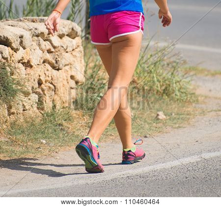 Fitness Woman Hiker On The Roadside.