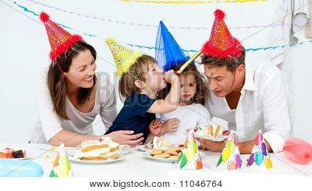 Happy Family Having Fn While Eating Birthday Cake