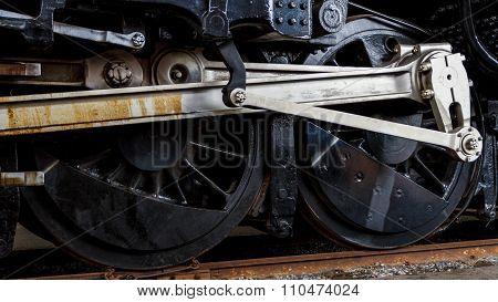Close Up Wheels On Stream Powered Locomotive.