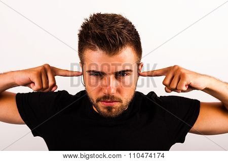 Young Man Puts Fingers In His Ears