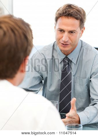 Charismatic Manager During A Meeting With An Employee