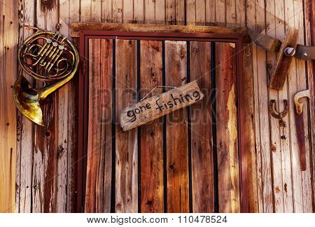 Gone fishing sign on old door