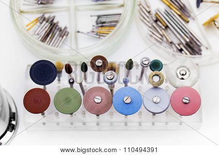 Set of dental burs and grinding wheels on a white background poster