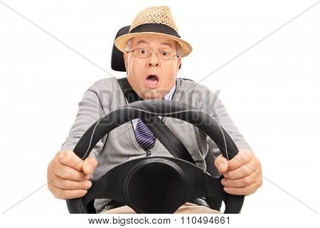 Scared senior holding a steering wheel and pressing the brake pedal to avoid a car crash isolated on white background