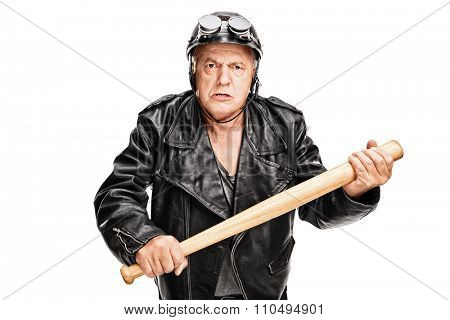Angry and violent senior motorcyclist holding a baseball bat and looking at the camera isolated on white background
