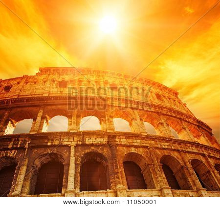 Picture of a sunset above Colosseum (Rome Italy)