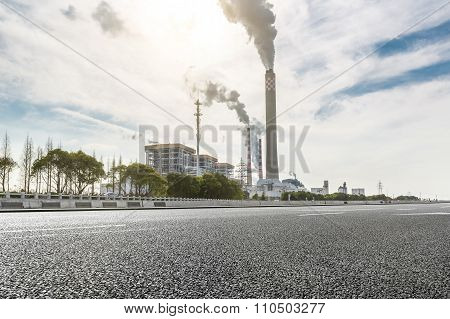 Wide angle of a road leading to a power plant