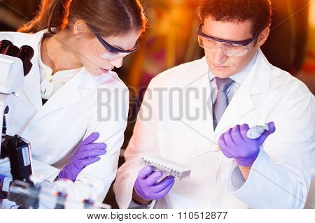 Scientist pipetting.