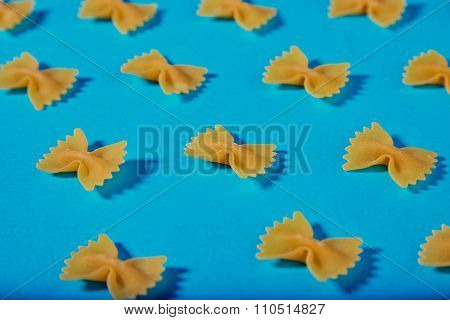 Italian Farfale Pasta Pattern On Turquoise Background Closeup