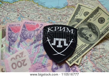 Kiev, Ukraine.NOV 13.Illustrative editorial. Chevron of Islamic extremist formation Crimea as part of Ukrainian Army.Background map and money. November 13, 2015 in Kiev, Ukraine