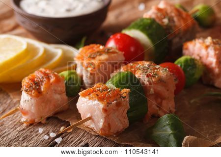 Grilled Salmon On Skewers And Tartar Sauce Macro. Horizontal