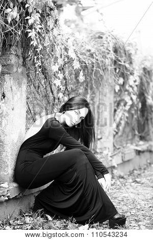 Fashion Woman Sitting Outdoors