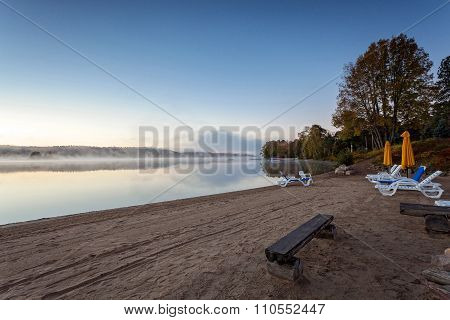 foggy morning in lake of Algonquin Provincial Park, Ontario, Canada with benches