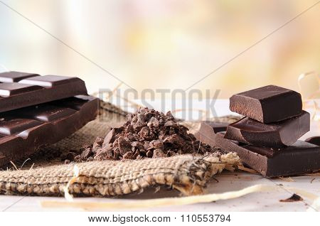 Artisan Chocolate Broken Tablet Stack With Portions And Chunks Horizontal