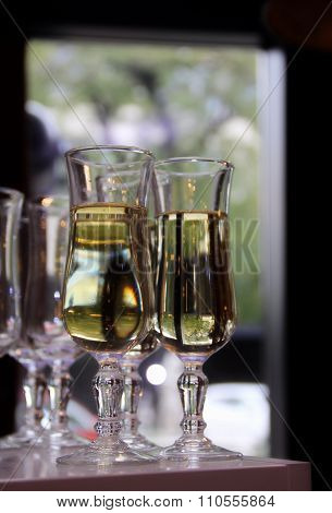 Glasses of white wine on the bar closeup
