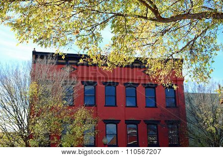 Autumn colors around a red building