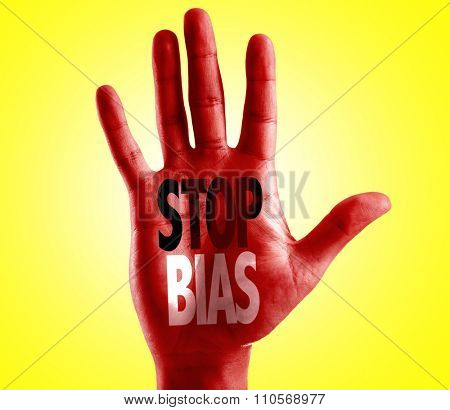 Stop Bias written on hand with yellow background