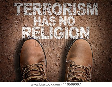 Top View of Boot on the trail with the text: Terrorism Has No Religion