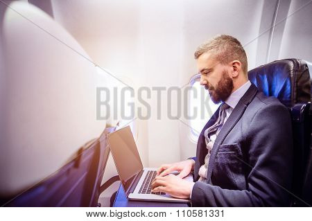 Businessman In Airplane