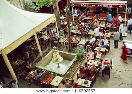 Crowd Of People Drinking Coffee In Outdoor Cafe In Popular Touristic Area Of Turkish Capital