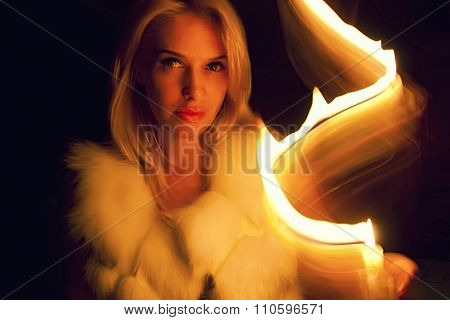 Beautiful Blonde Girl In The Candlelight