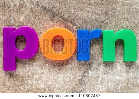 The word Porn spelled out by colorful plastic letters poster