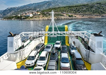 Car Ferry Boat With Rows Of Cars Is Leaving The Port.