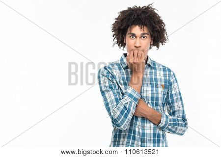 Portrait of a scared afro american man with curly hair standing isolated on a white background