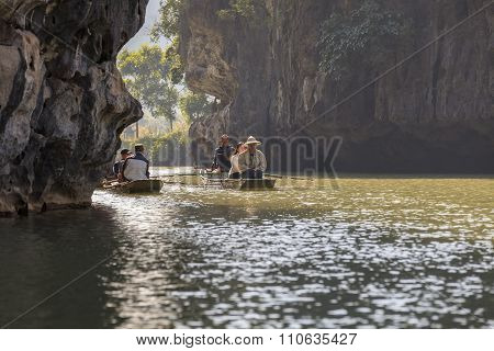 sailing through the caves of Nihn Bihn, Vietnam