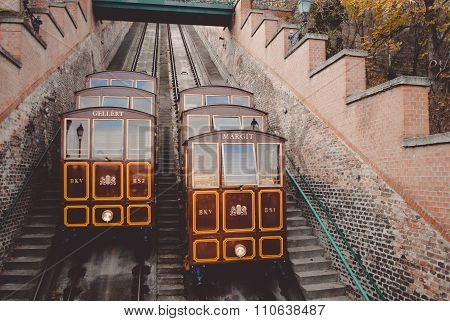 Picture of Castle Hill funicular in Budapest. Awesome retro trains on their way on autumn outdoor blurred background. poster