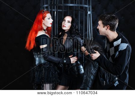 Two Women Dressed In Fetish Play, The Man Looks.