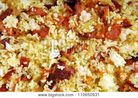 dish of rice with ham carrots and onion