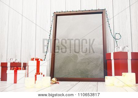Blank Picture Frame  With Gift Boxes And Glowing Candlesticks On Wooden Floor At White Wood Backgrou