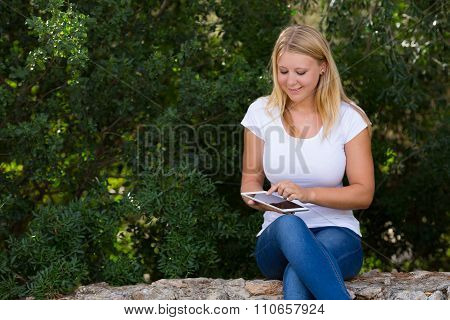 Teenager Using Internet Outdoor In The Park
