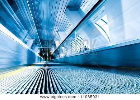 Diminishing Stairway Of Blue Empty Business Escalator