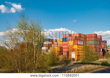 HAMBURG, GERMANY - May 1, 2013: Cargo container stored at the port area.  Harbor freight terminal German sea harbor on the river Elbe the central hub for trade with Eastern and Northern Europe