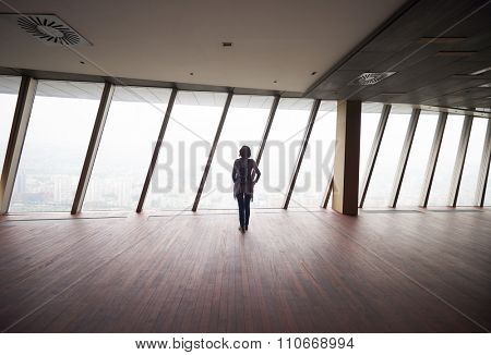 young successful startup business woman in penthouse,  modern bright duplex office apartment interior  with big windows