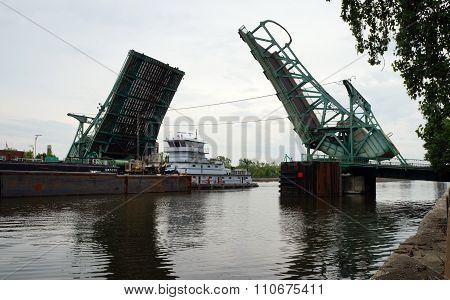 Towboat Pushes Barge Under Bridge