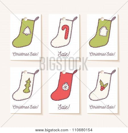 Set of holiday sale tags. Hand drawn christmas socks with different sewn decorations