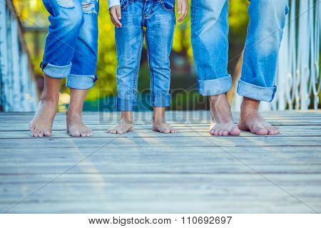 Happy Family on a Walk in Summer. Child with Parents Together. Feet Barefoot. Healthy Lifestyle. Dad
