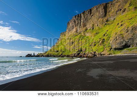 Panoramic photo of a black sandy beach at Vik, Iceland
