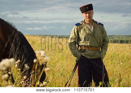 Russian Cossack With A Horse Resting In The Summer Field