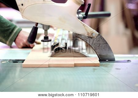 Wood Factory Worker Cutting Wood Boards With Sliding Compound Mitre saw