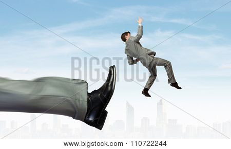 Businessman kicked by his boss big foot