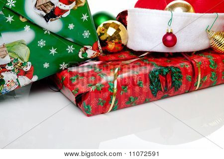 Christmas Presents With A Santa Hat And Tree Oranaments