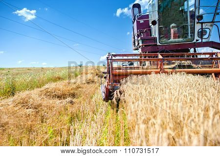 Industrial Vintage Harvesting Machinery In Wheat Crops