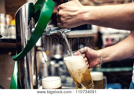 Barman Pouring Or Brewing A Draught Beer At Restaurant, Bar Or Pub